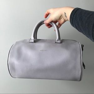Matt & Nat // Row Barrel Crossbody Bag in Lilac